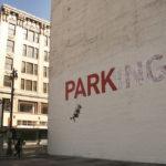 street art by banksy parking