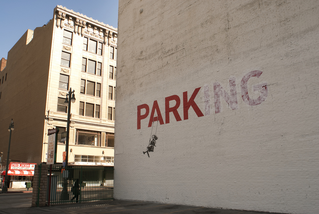street art by banksy parking