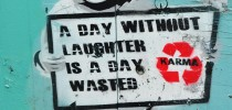 street_art_karma_a_day_without_laughter_is_a_day_wasted