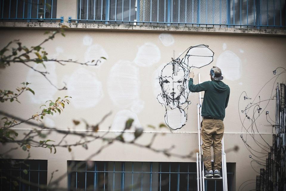 Street artist Iemza painting at La Fileuse, Reims, France 2