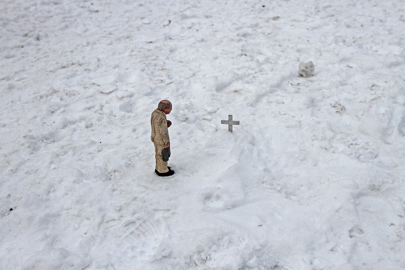 Funeral for a concrete figure. Anderletch, Belgium. Cement Eclipses -By Isaac Cordal 2013 in 12