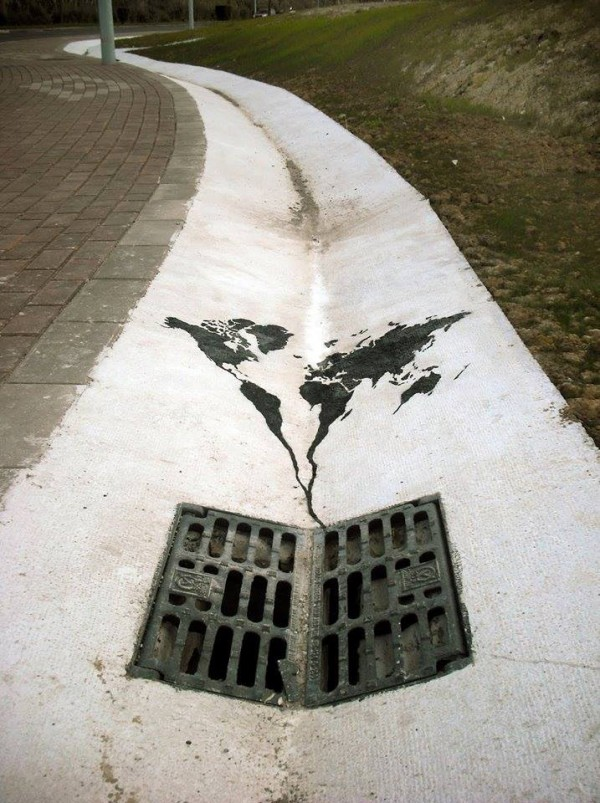 The world going down the drain - By Pejac in Spain