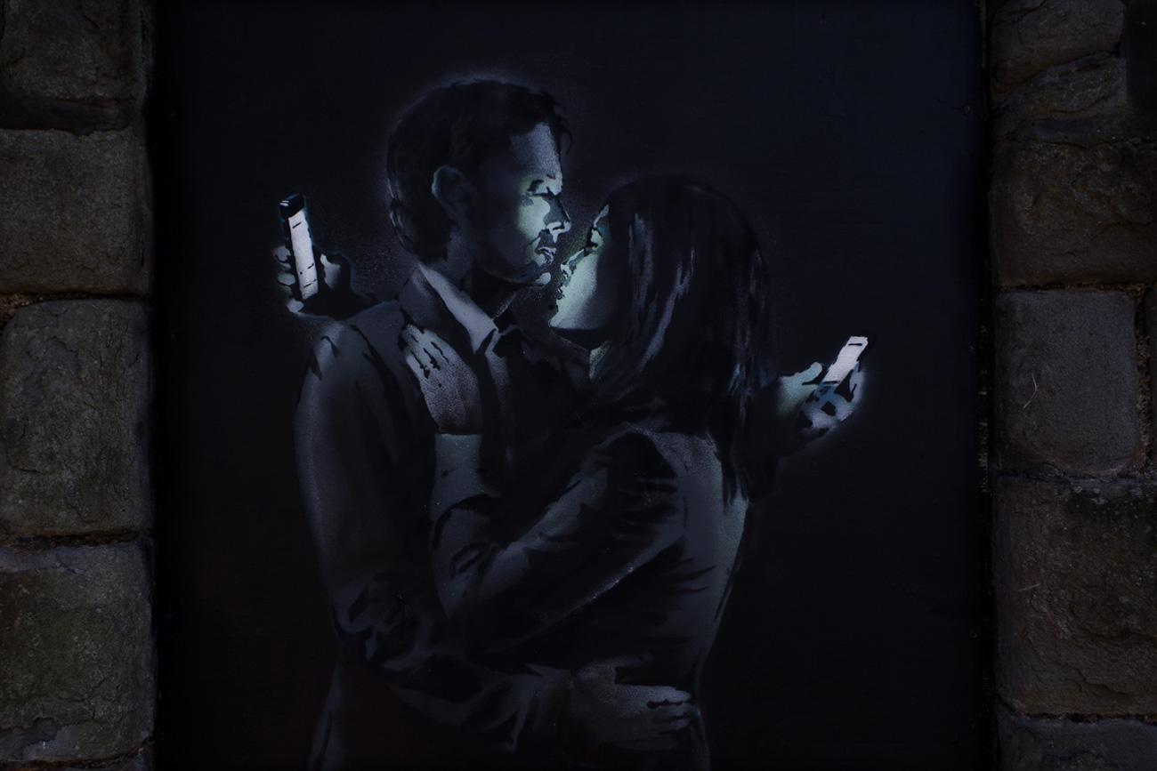 Phone Lovers - Street Art by Banksy in Bristol, England 1