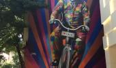 Genial is riding a bike. Street Art by Kobra in São Paulo, Brazil 1