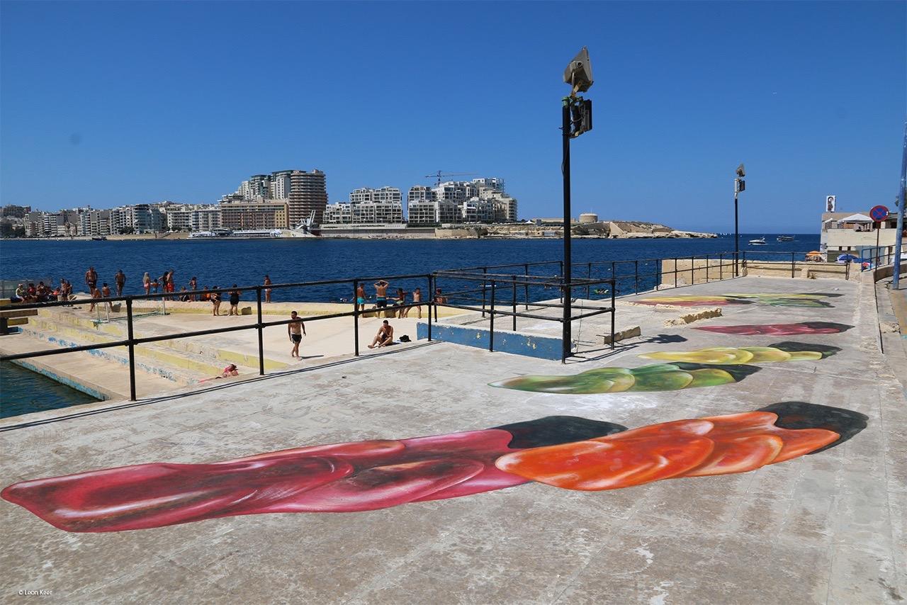 3d street art by Leon Keer at Malta Streetart Festival. Gummy bears gather around 1