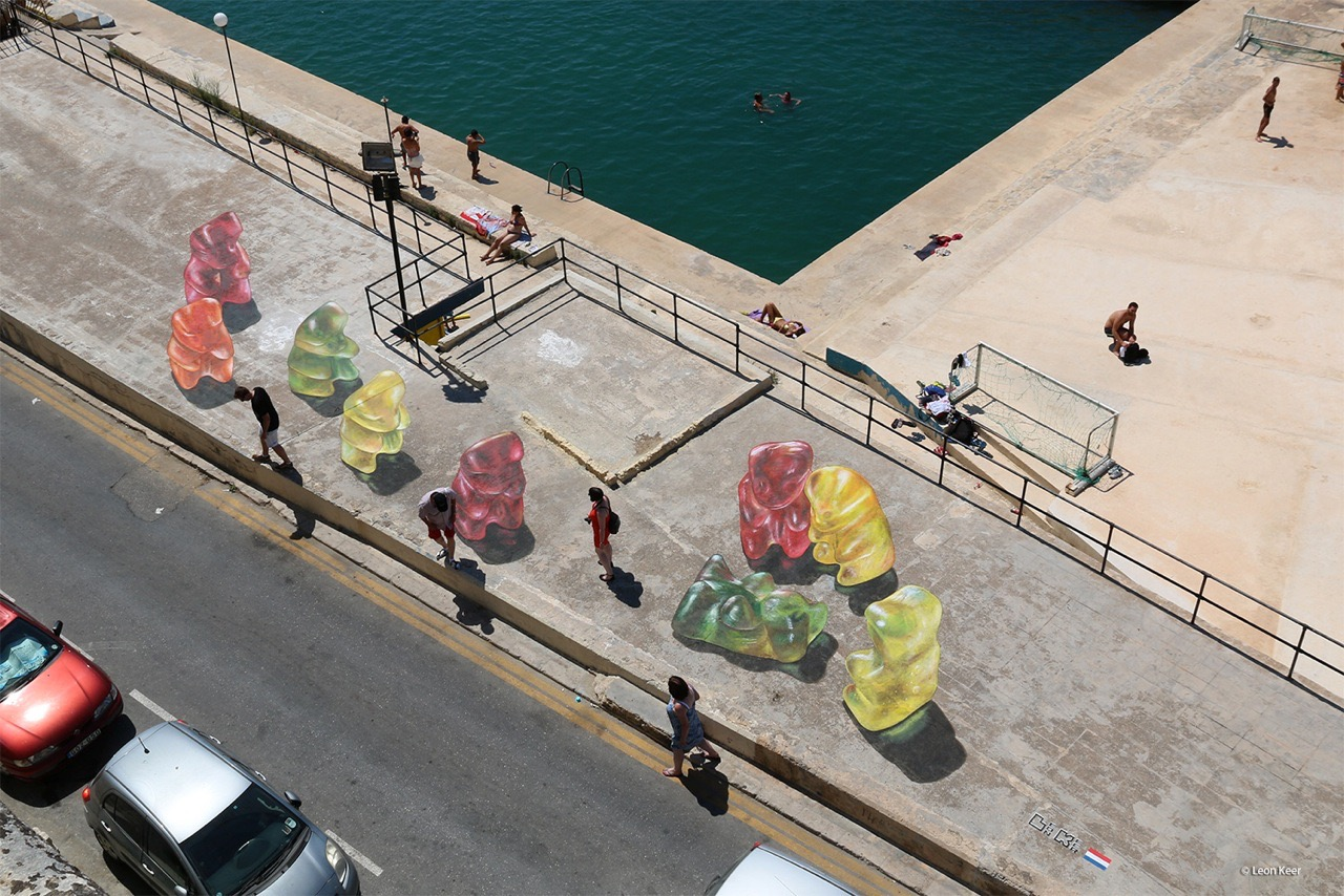 3d street art by Leon Keer at Malta Streetart Festival. Gummy bears gather around 2