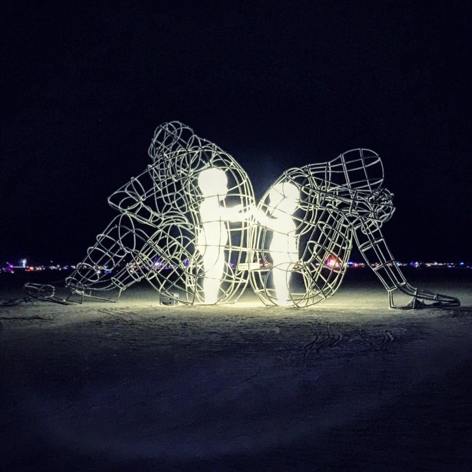 Burning Man 2015 by Alexander Milov - Two adults back to back