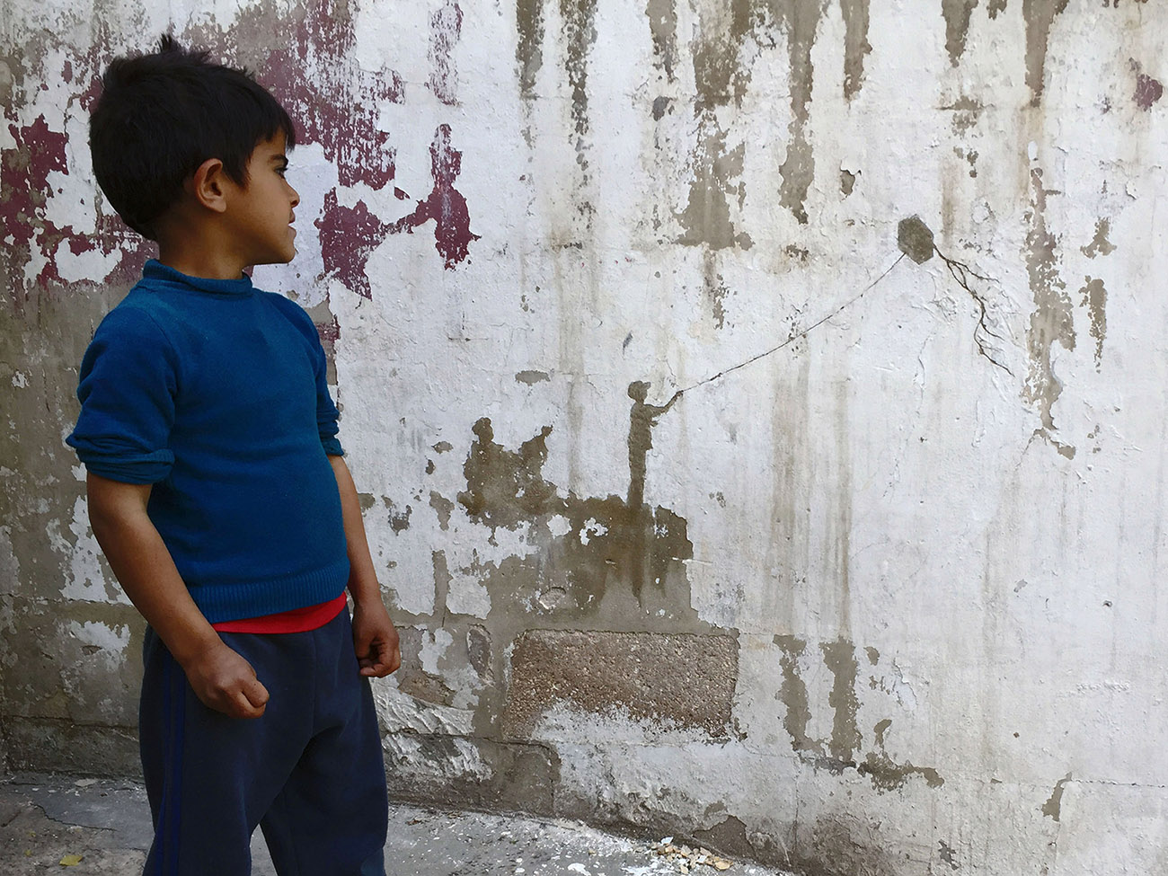 Street Art by Pejac - In Al-Hussein, a Palestinian refugee camp in Amman Jordan