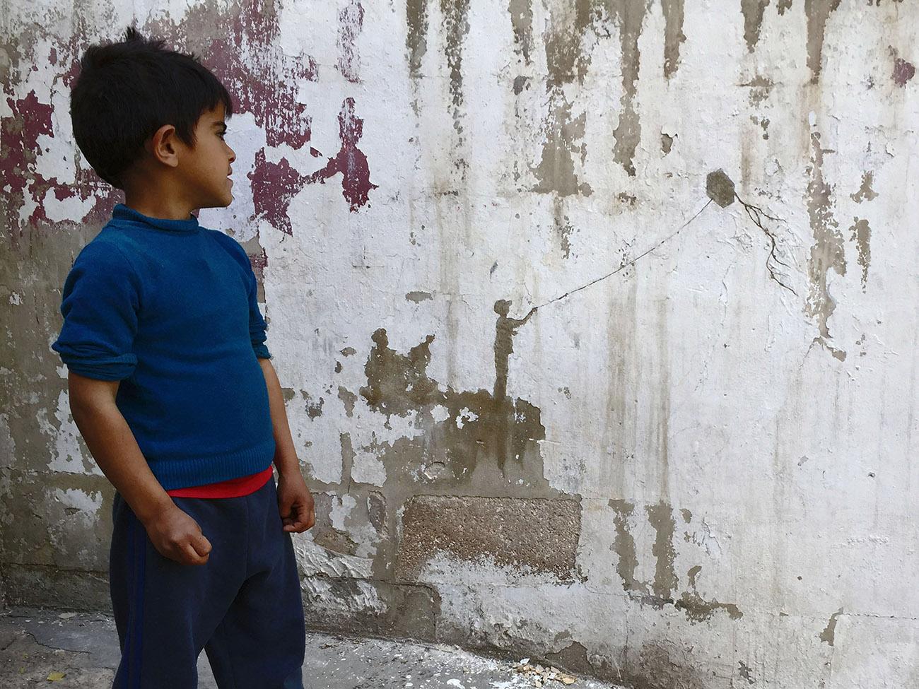 Street Art by Pejac in Al-Hussein, a Palestinian refugee camp in Amman Jordan 5