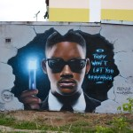 graffiti-street-art-mural-by-Pieksa-in-Nowa-Sol-Poland-on-Men-In-Black-with-Will-Smith-and-Tommy-Lee-Jones-they-won´t-let-you-remember
